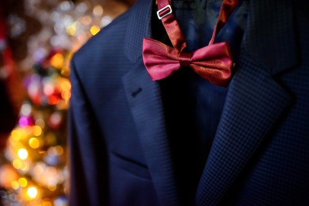 Dark blue wedding suit and wine-colored bow-tie