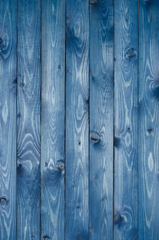 Dark blue wooden background made of a narrow board, painted in dark blue.