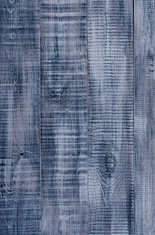Dark blue wooden background made of a wide board, painted in dark blue.