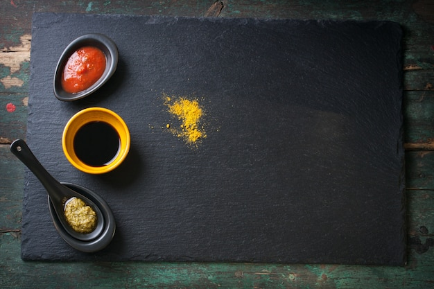 Dark board with condiments
