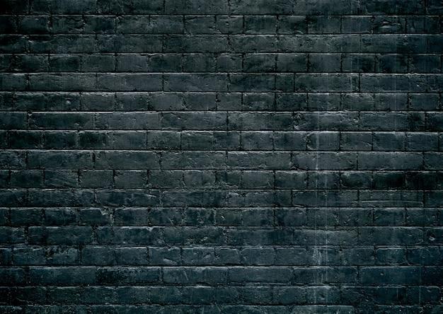 暗いレンガのテクスチャ壁の背景。