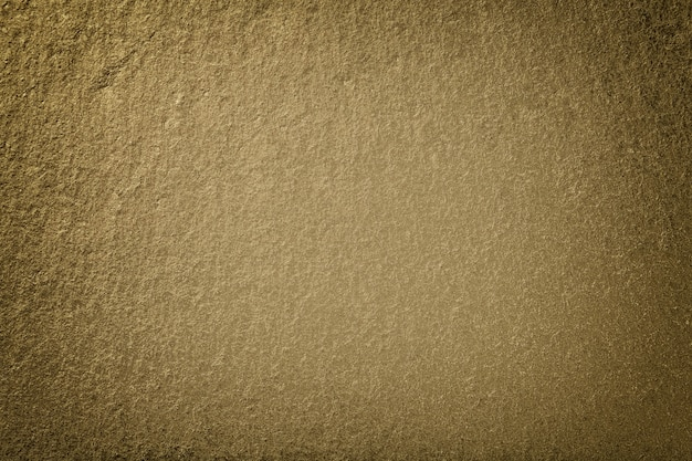 Dark bronze background of natural slate. texture of brown stone closeup. graphite backdrop macro