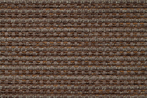 Dark brown background from checkered pattern textile, closeup. structure of the wicker fabric macro.