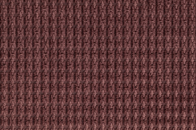 Dark brown background from soft fleecy fabric close up. texture of textiles macro