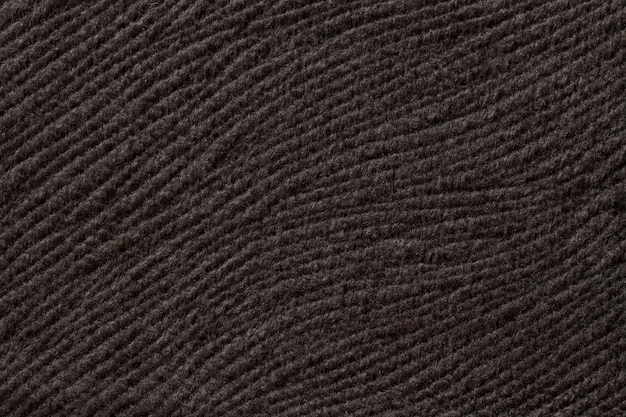 Dark brown background from soft textile material, fabric with natural texture,