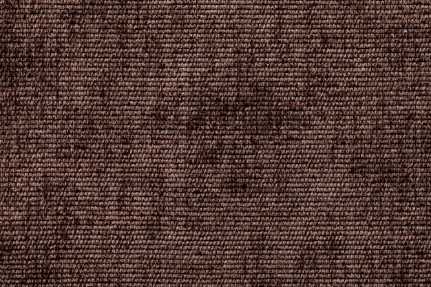 Dark brown background from soft textile material. fabric with natural texture.