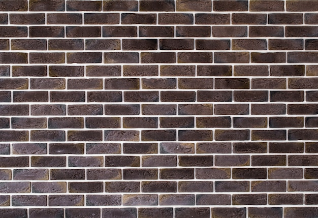 Dark brown brick wall, creative back-phonon, closeup
