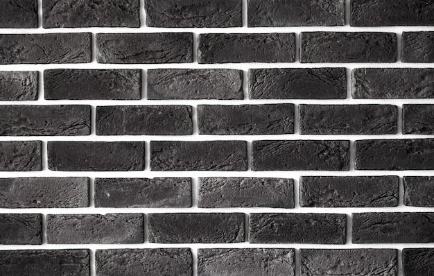 ダークブラウンのレンガの壁、クリエイティブなバックフォノン、クローズアップ