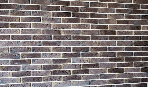 Dark brown brick wall