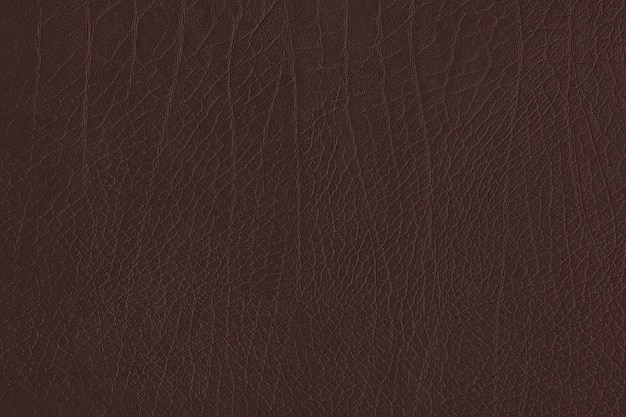 Dark brown creased leather textured background