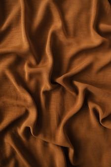Dark brown crumpled satin textile cloth texture