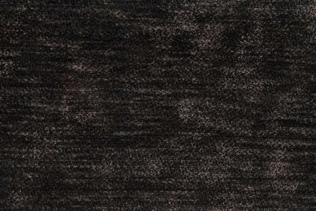Dark brown fluffy background of soft, fleecy cloth, texture of light nappy textile