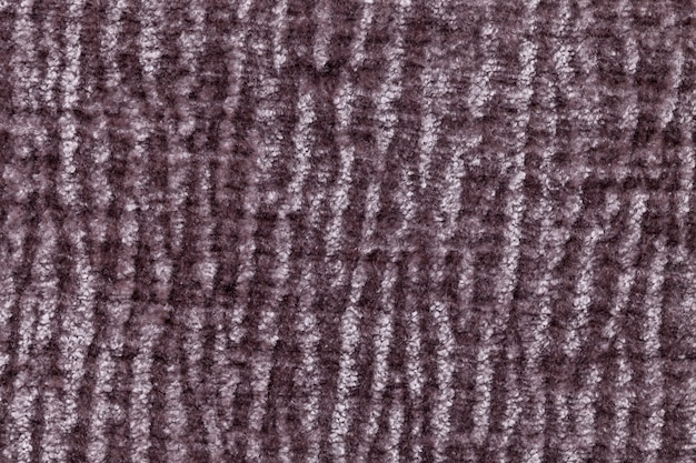 Dark brown fluffy soft, fleecy cloth. texture of textile closeup