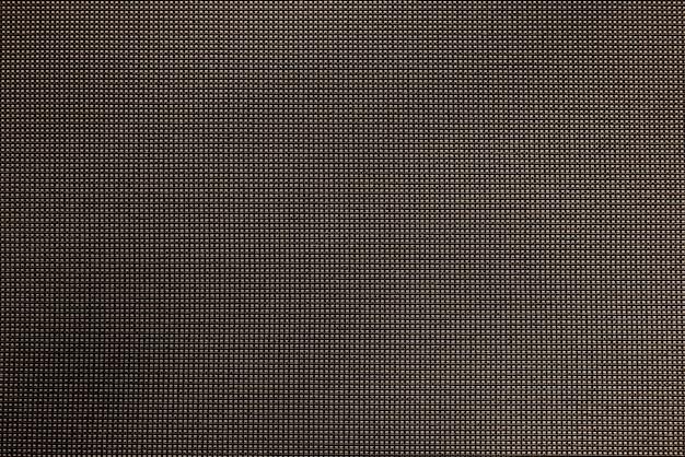 ダークブラウンのギンガム生地の織り目加工の背景