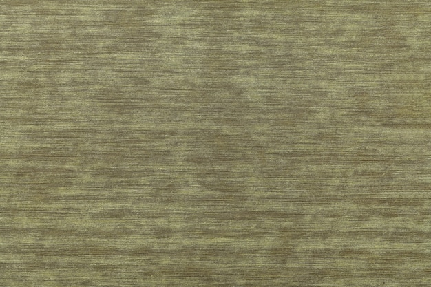 Dark brown and green shabby vintage laminate. wooden texture background, closeup. structure of old decorative wood backdrop with olive gnarled pattern. decor wallpaper.