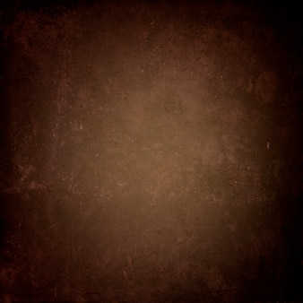 Dark brown grunge background, old paper texture with heels and streaks for design
