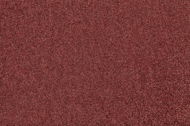 Dark brown matt suede fabric closeup. velvet texture of felt background