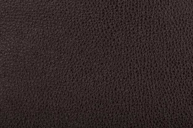Темно-коричневый фон текстуры натуральной кожи