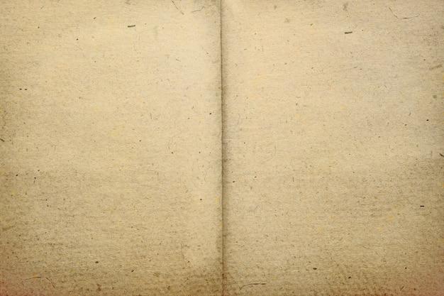 暗い茶色の紙テクスチャ背景。