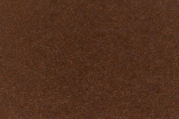 黑褐色纸纹理纸板背景。高分辨率照片。