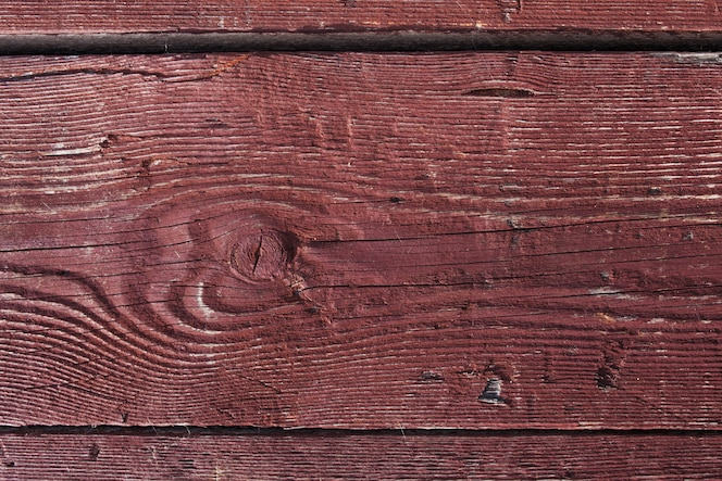 Dark brown scratched wooden board. wood texture. background wooden board with cracked paint. color- peel wood texture