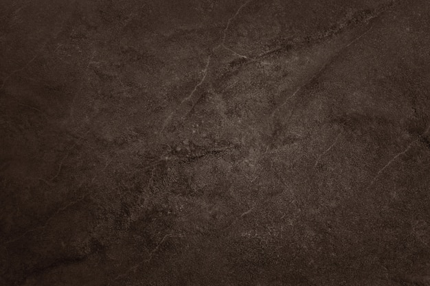 Dark brown slate texture, background of natural black stone wall.