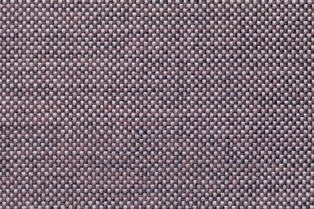 Dark brown textile background closeup. structure of the fabric macro