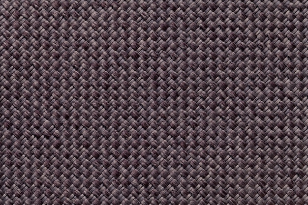 Dark brown textile background of the fabric