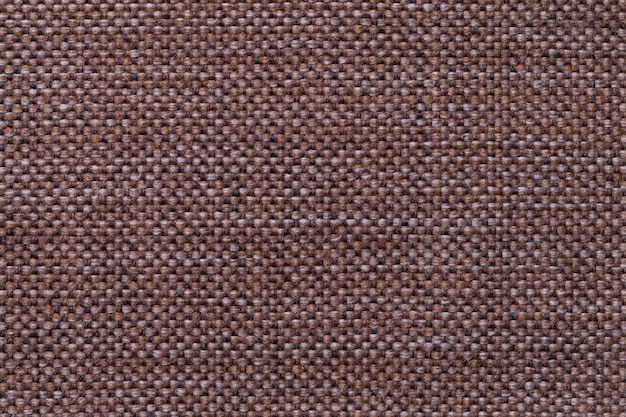 Dark brown textile background with checkered pattern, closeup. structure of the fabric macro.