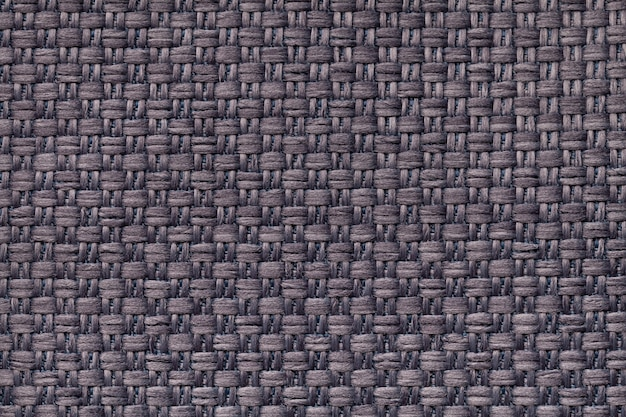 Dark brown textile background with checkered pattern. structure of fabric macro..