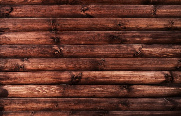 Dark brown wood siding closeup for background or texture