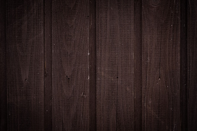 Dark brown wooden wall with vertical boards, texture for background