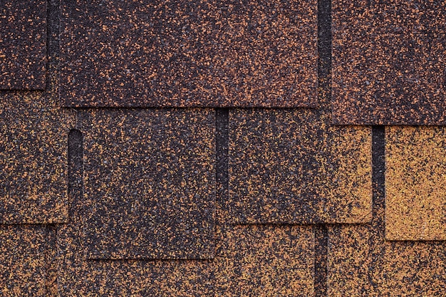 Dark brown and yellow surface of roofing tiles.