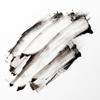 白い背景の暗いブラシストローク