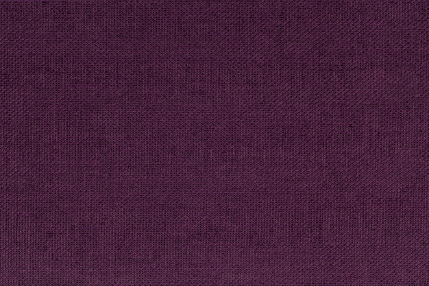 Dark burgundy, purple from a textile material. fabric with natural texture. backdrop.