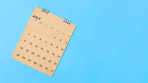 Dark calendar on blue background, planning concept.