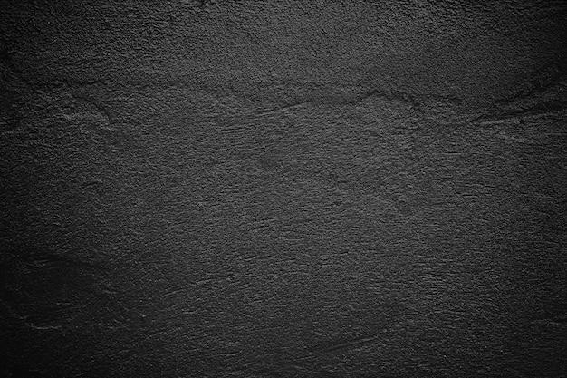 暗いセメントまたはコンクリートテクスチャ壁の背景、黒の背景。