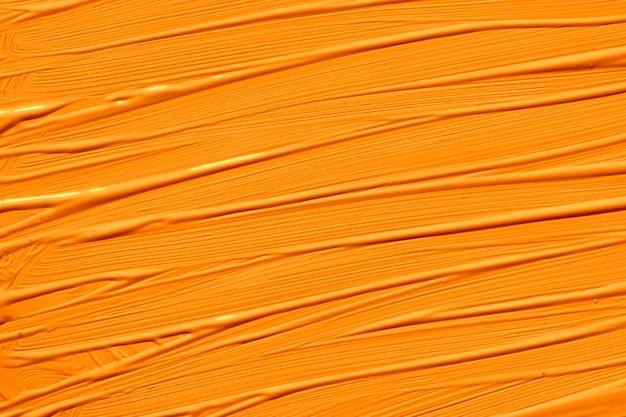 2020年の暗いチェダーオレンジのトレンディな色。ブラシストロークで抽象芸術の背景。モノクロカラーテクスチャ。