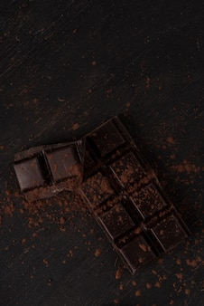 Dark chocolate bar covered with chocolate powder
