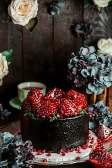 Dark chocolate cake topped with pomegranate seeds
