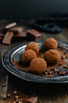Dark chocolate candy truffles with sichuan pepper