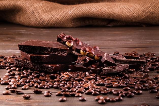 Dark chocolate lies on coffee beans
