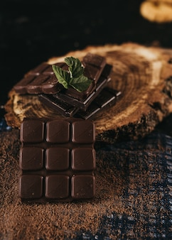 Dark chocolate with and walnut kernel on a rustic table