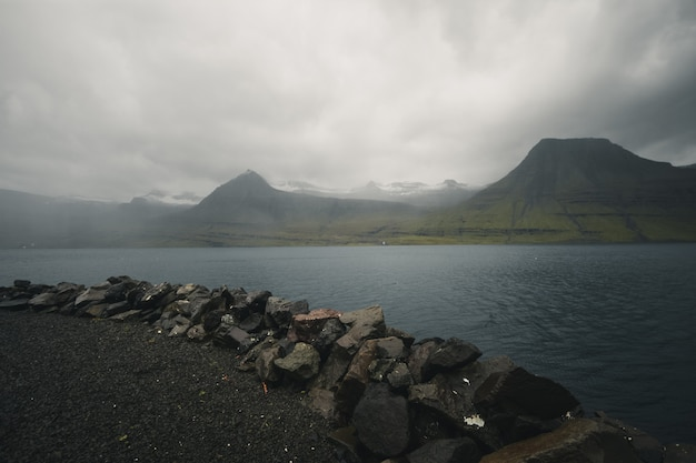 Dark clouds above iceland fjord
