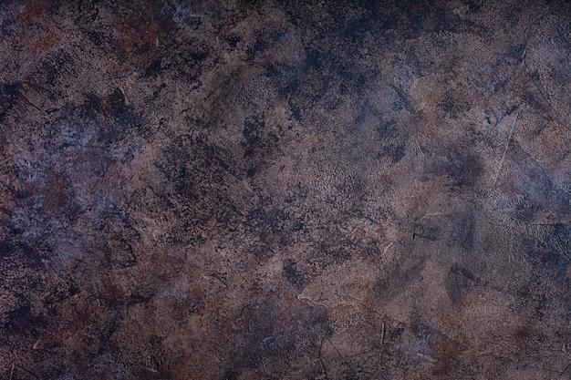 Темная предпосылка текстуры бетонной стены.