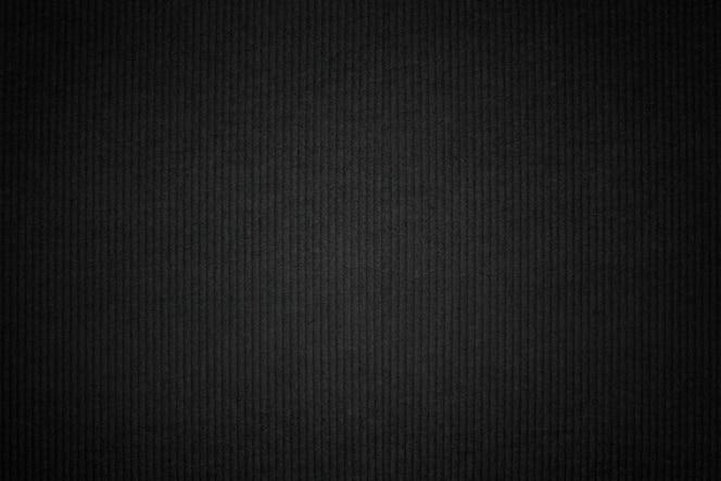 Dark corduroy fabric textured backdrop