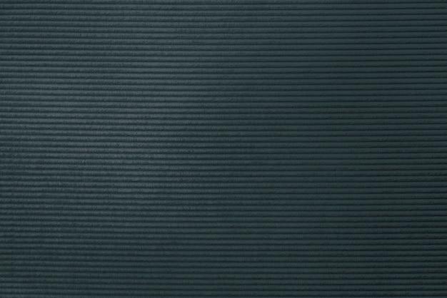 暗いコーデュロイ生地の織り目加工の背景