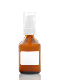 Dark cosmetic amber glass bottle with white label isolated