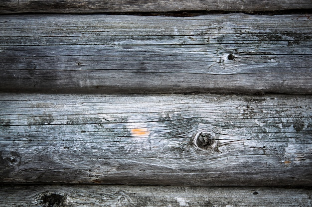 Dark country timbered wooden loghouse wall with fracture