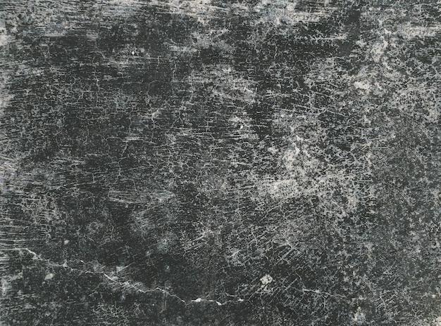 Темный грязный деревенский бетонный пол
